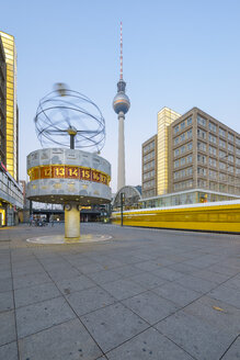 Germany, Berlin, view to world clock at Alexanderplatz with television tower in the background - RJ000544