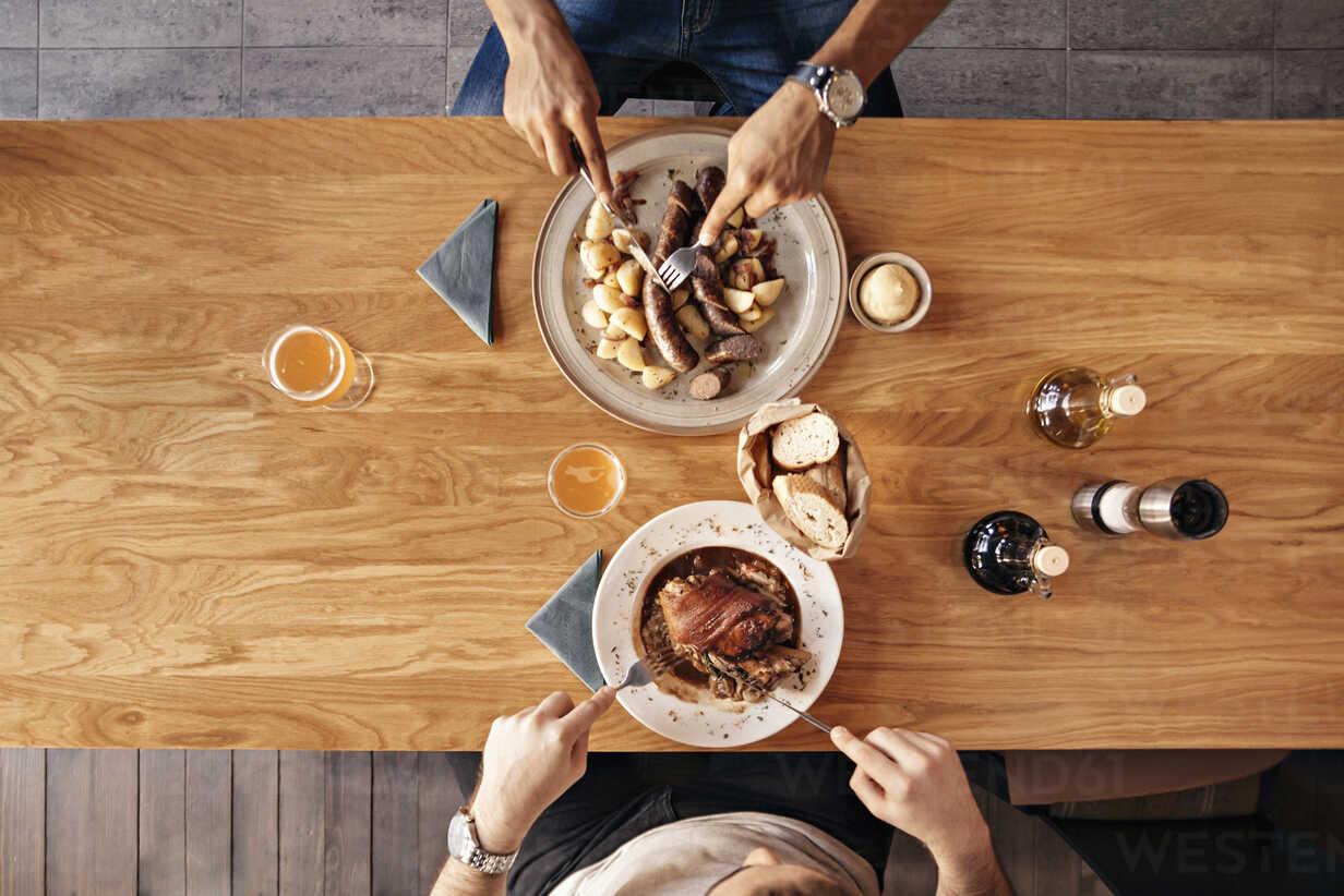 Two men in restaurant having lunch - ZEDF000014 - Zeljko Dangubic/Westend61