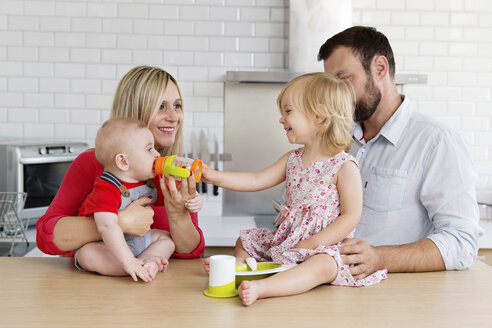 Happy family of four in the kitchen - LITF000019