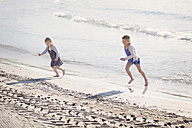 Two children playing at seafront - LITF000025