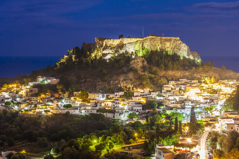 Greece, Aegean Islands, Rhodes, Lindos, View to Acropolis of Lindos at night - WDF003443