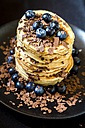 Stack of pancakes with gave syrup, blueberries and chocolate flakes - SARF002356