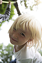 Portrait of smiling blond girl outdoors - FKF001605