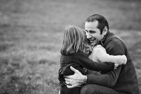 Toddler girls hugging her father - LITF000057
