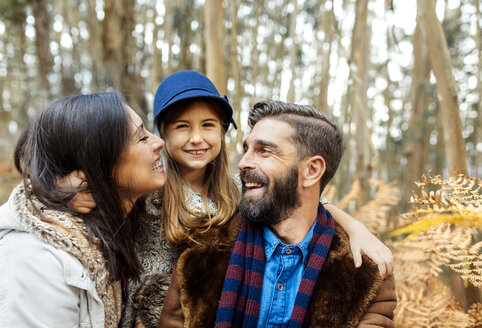 Happy parents with little daughter in nature - MGOF001108