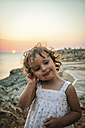 Spain, Menorca, portrait of smiling little girl at sunset - MGOF001117