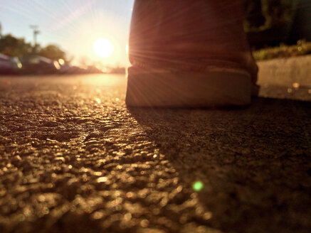 low angle backlit shot of a leather shoe on a street - BMA000071