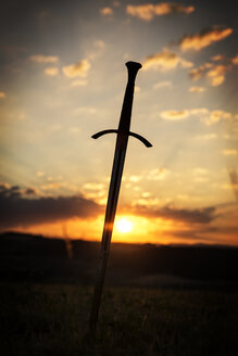 Sword in rural landscape at sunrise - MID000701