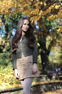 Portrait of young woman with long brown hair in autumn - GDF000935