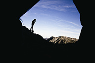 Spain, Picos de Europa, silhouette of a man with mountains landscape - ABZF000160
