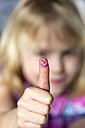 Little girl showing thumb up with smiling face - JFEF000759