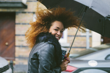 Portrait of smiling woman with umbrella on a rainy day - BOYF000044