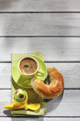 Breakfast with coloured Easter egg, cup of coffee and pastry - CSF026884