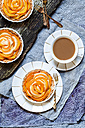 Almond pies with kaki slices and cup of white coffee - SBDF002495