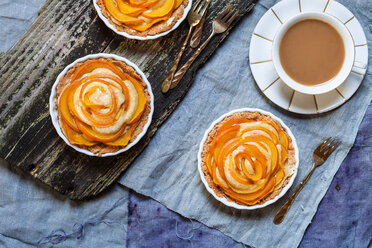 Almond pies with kaki slices and cup of white coffee - SBDF002498