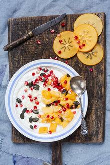 Dish of natural yoghurt, kaki, pomegranate seed, almond and pumpkin seed - SBDF002501