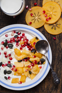 Dish of natural yoghurt, kaki, pomegranate seed, almond and pumpkin seed - SBDF002504