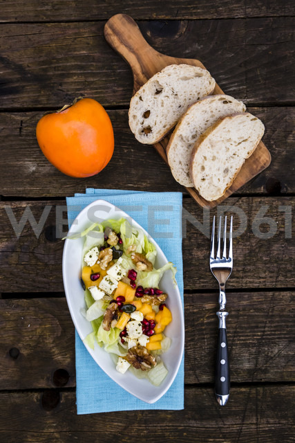 Autumnal salad with kaki, feta cheese, iceberg lettuce, pumpkin seeds, pomegranate and walnuts - SARF002389
