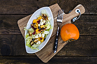 Autumnal salad with kaki, feta cheese, iceberg lettuce, pumpkin seeds, pomegranate and walnuts - SARF002392