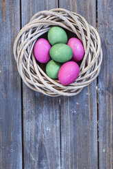 Green and pink Easter eggs in nest - SBDF002541