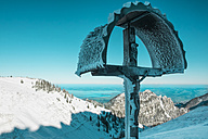 Germany, Bavaria, Chiemgau, Kampenwand, crucifix high above Chiemsee in winter - HAMF000113
