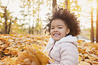Little girl playing in autumn park - HAPF000009