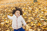 Little girl playing in autumn park - HAPF000018