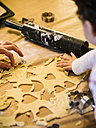 Mother and little daughter cutting out Christmas cookies - KRPF001662