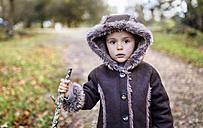 Portrait of little girl wearing hooded jacket in autumn - MGOF001161