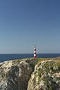 Portugal, Algarve, Porto Covo, view to navigational light on the rock - KBF000348