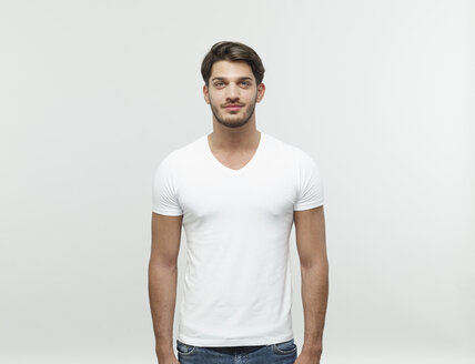 Portrait of bearded young blond man wearing white t-shirt - RHF001112
