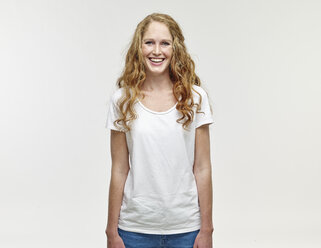 Portrait of smiling young woman with long blond hair - RHF001136