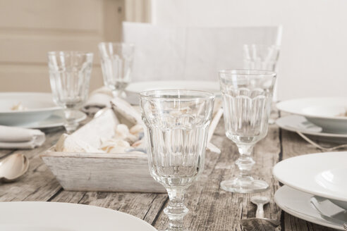 Empty wine glasses on laid table - LVF004297