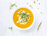 Bowl of carrot pumpkin soup with topping - KNTF000209