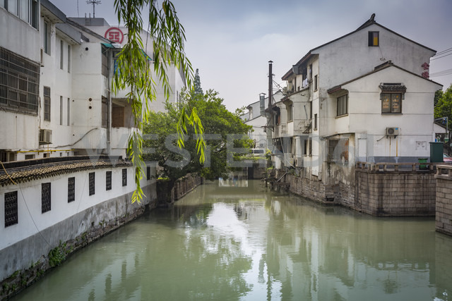 China, Jiangsu Province, Suzhou, Canal and residential houses - NKF000416