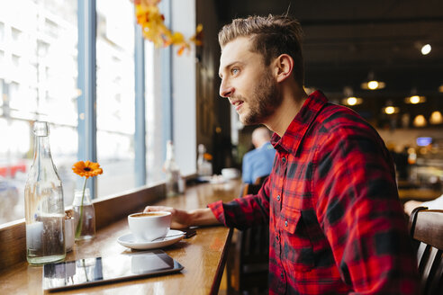 Man in a coffee shop looking out of window - BOYF000052