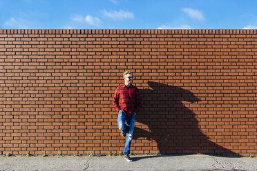 Young man leaning against brick wall - BOYF000061