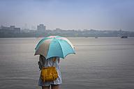 China, Zhejiang, Hangzhou, Women with umbrella looking over the West lake - NK000421