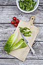 Chopped romaine lettuce and kitchen knife wooden board - LVF004331