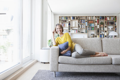 Relaxed woman at home on couch - RBF003633