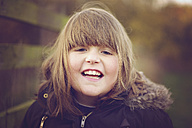 Portrait of girl laughing, winter jacket - MJOF001126