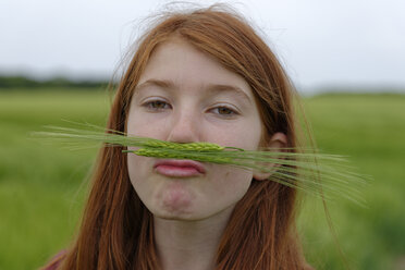 Portrait of teenage girl with barley moustache - LBF001314