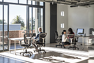 Young professionals working in open office - ZEF007494