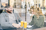 Italy, Milan, couple in love sitting in a coffee shop having fun - OIPF000025