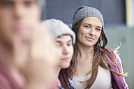 Portrait of young woman with friends outdoors - ZEF007600