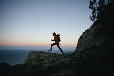 Spain, Catalunya, Girona, woman hiking at twilight - EBSF001171