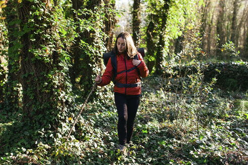 Spain, Catalunya, Girona, female hiker walking in the woods - EBSF001192