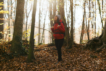 Spain, Catalunya, Girona, female hiker standing in the woods - EBSF001195