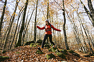Spain, Catalunya, Girona, female hiker walking in the woods - EBSF001201