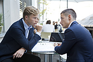 Two businessmen thinking about file - WESTF021595